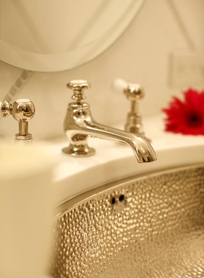 Hammered nickel sink in the Master Bathr