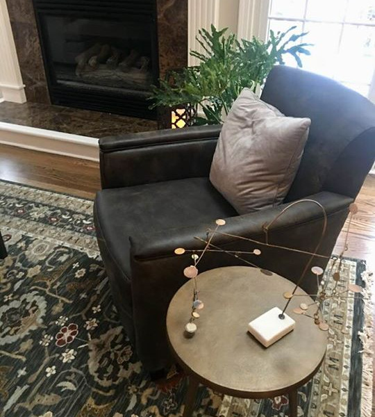 Relax in this lounge chair by the fireplace