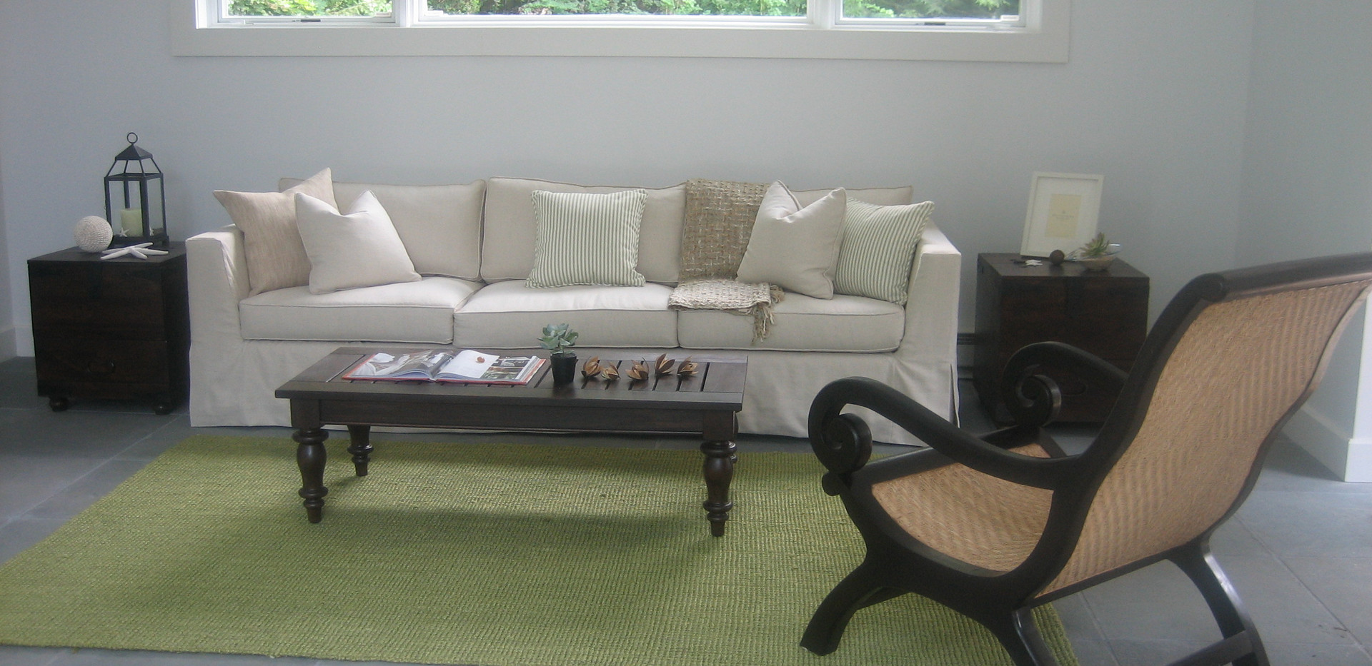 poolhouse sofa shot with plant chair aga