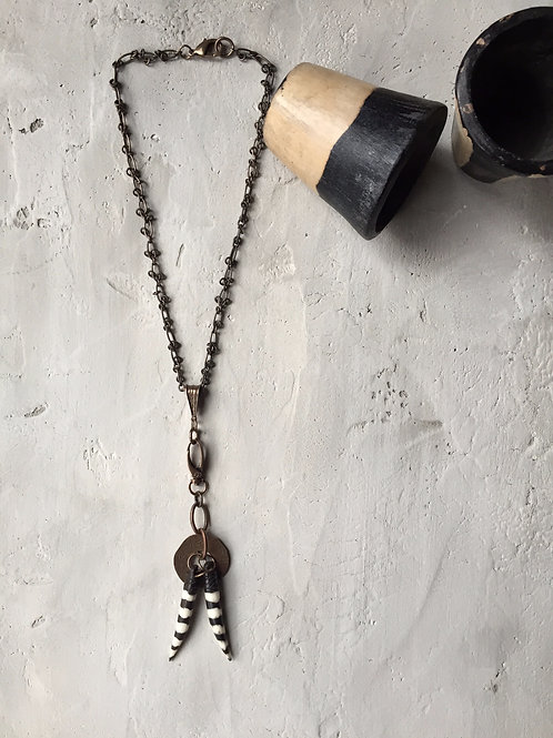 disc + black/ivory striped bone necklace