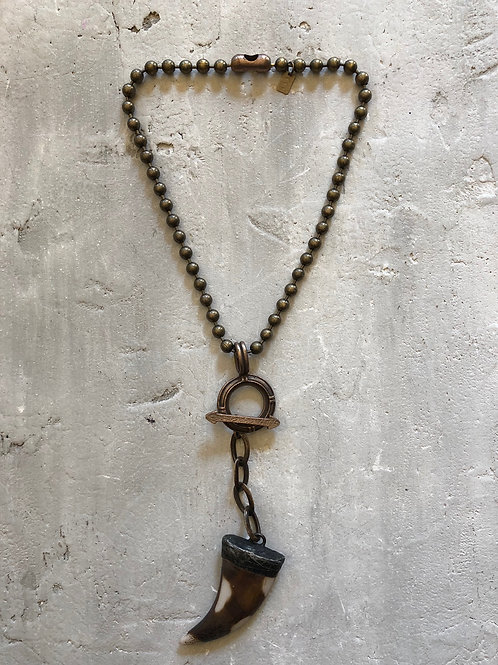 spotted bone on brass ball chain