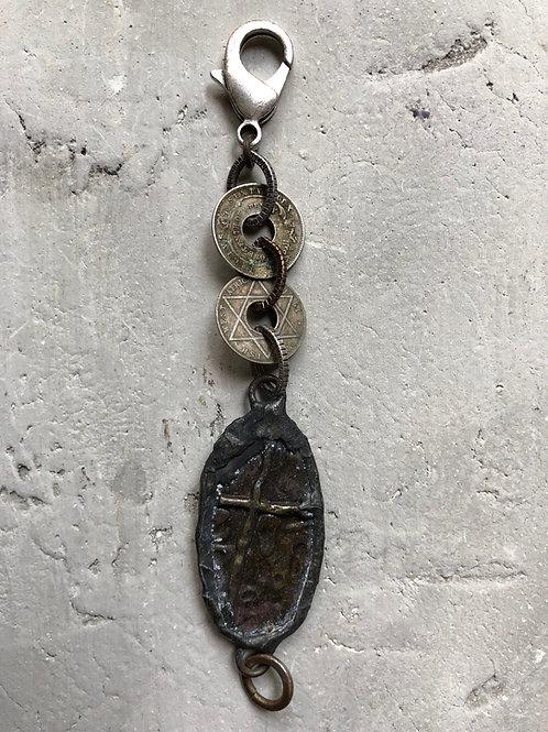 Oblong brass cross w/ African coins
