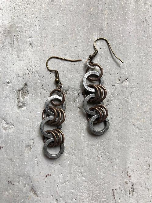 Heavy silver cricles w/ 7 brass rings