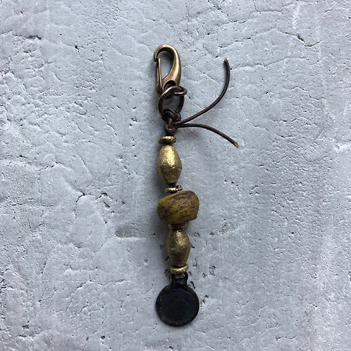 Mustard Hebron bead w/brass beads