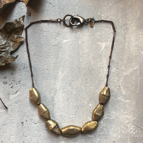 Oblong African brass bicone beads