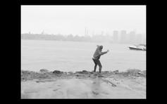 12. Nathan throws rocks on the river banks.