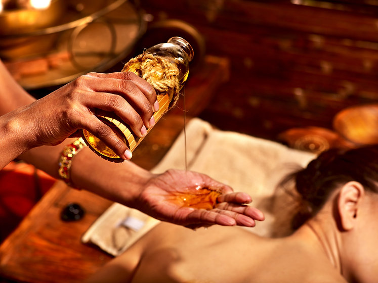 ayurveda pouring oil for massage.jpg