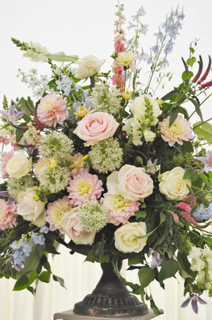 Pastel urn filled with flowers.jpg