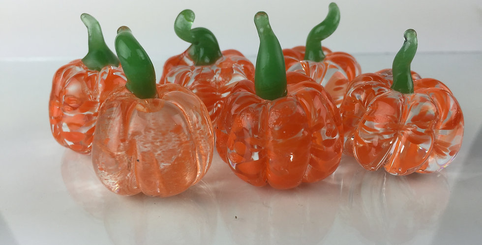 Small, solid, color pumpkin