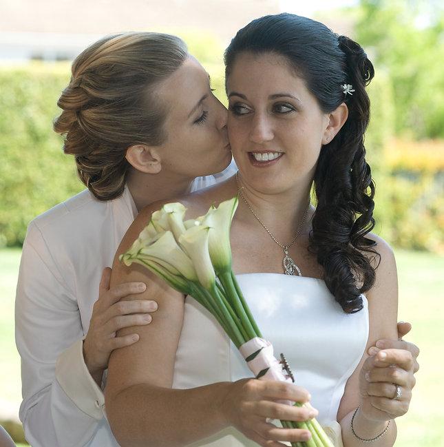Lesbians Deb and Lourdes celebrate at their wedding.