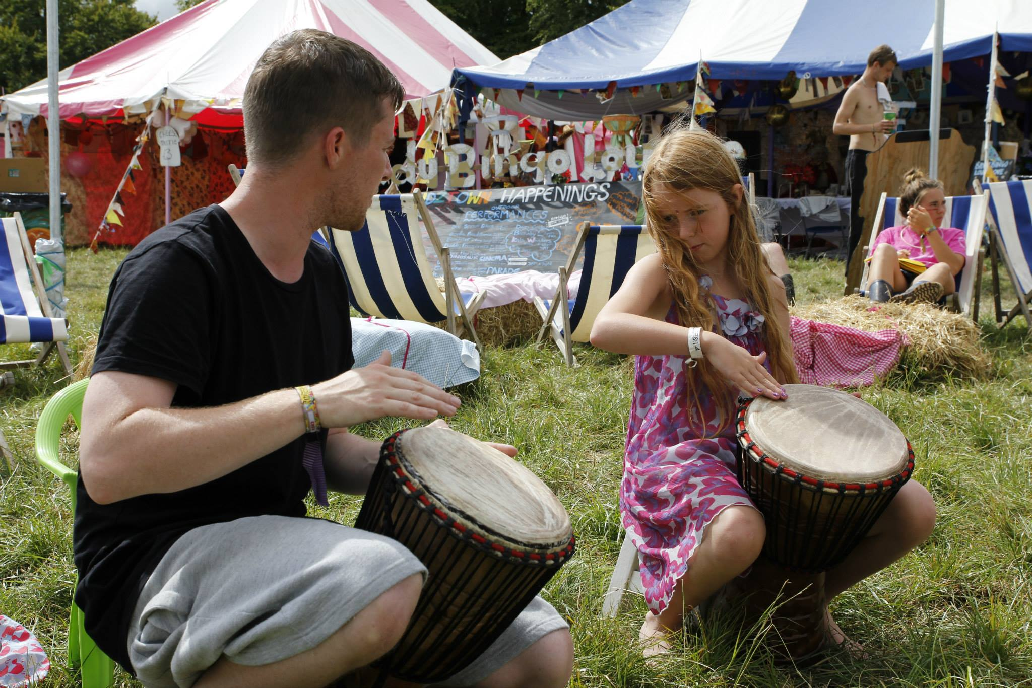 Sam in Djembe workshop in Kidztown, Boomtown