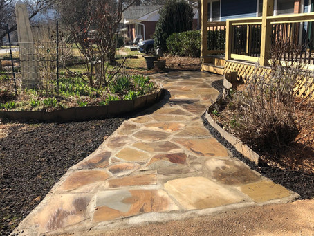 Flagstone walkway with mortared joints.