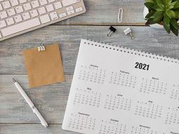 top-view-desk-calendar-with-succulent-plant.jpg