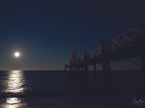 Lever de pleine lune lors d'une éclipse sur l'Estacade