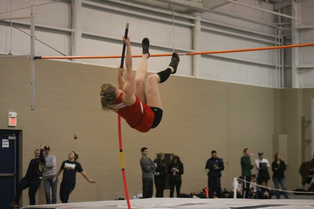 Senior Danielle Hoffman soaring high over the bar at the Trine Invitational on Friday, Jan. 29.