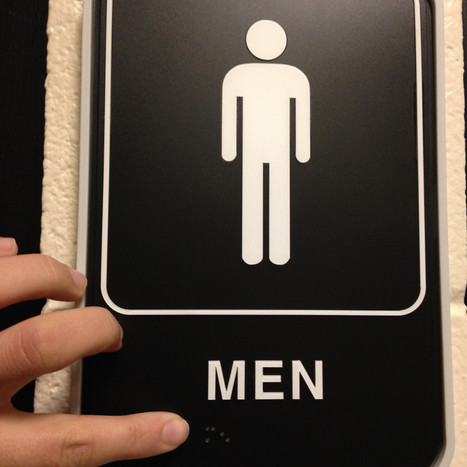 Going braille Olivet installs braille signs near bathroom doors and exits