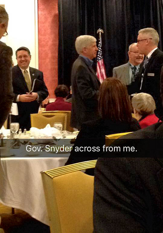 Gov. Snyder shakes hands with members of the media.