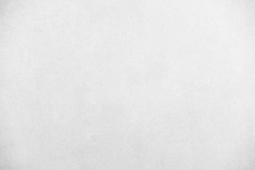 Una pared blanca con textura, simlemente para resaltar el texto.
