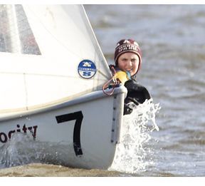 Summit High School sailor in sail boat