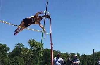 Summit High School girl pole vaulting