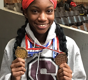 Summit High School track star hold medals