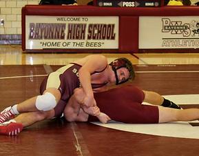 Summit High School wrestler in a match
