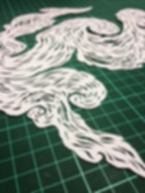 Hand cut swirl paper