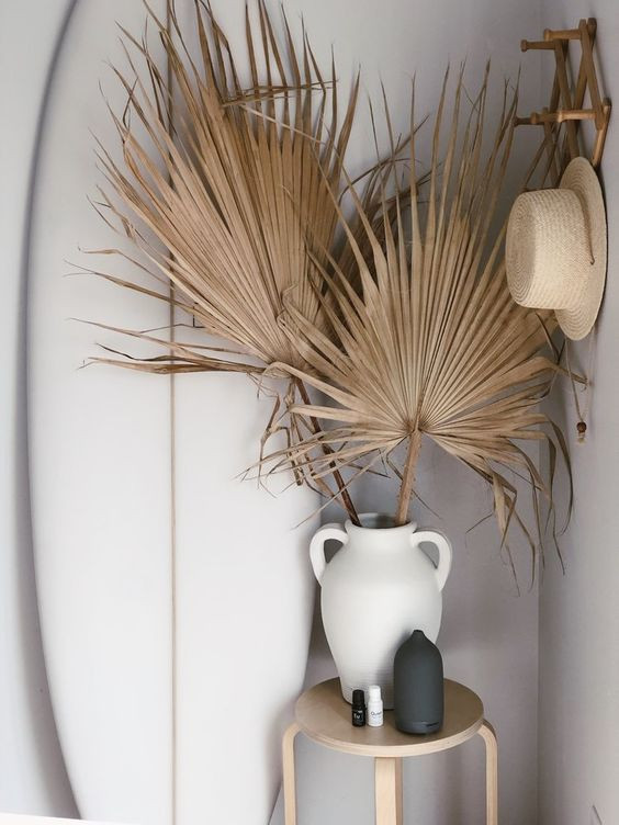 bohemian interior design dried palm fronds in vase