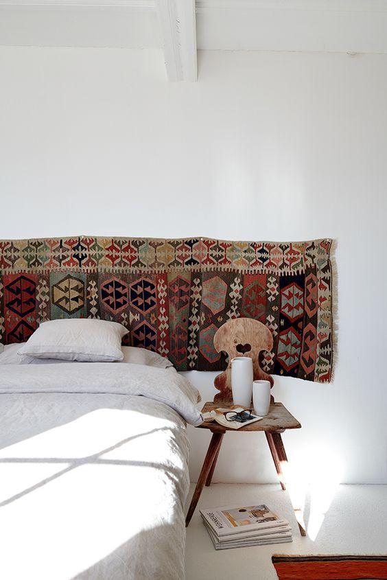 kilim rug as headboard rug hung on wall