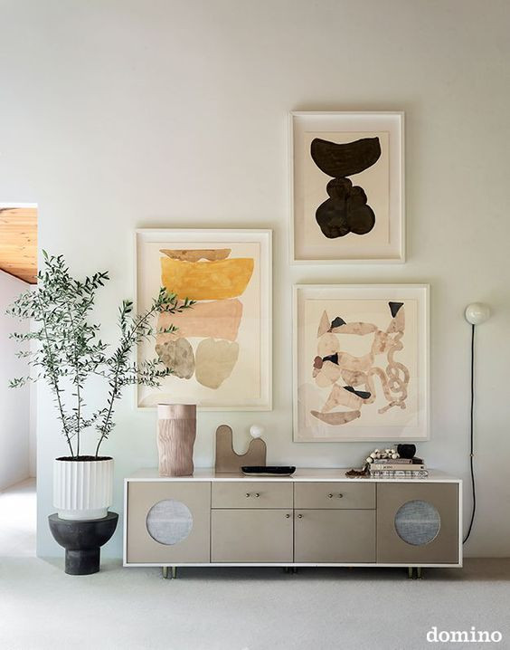 Abstract modern gallery wall console styling bohemian modern living room
