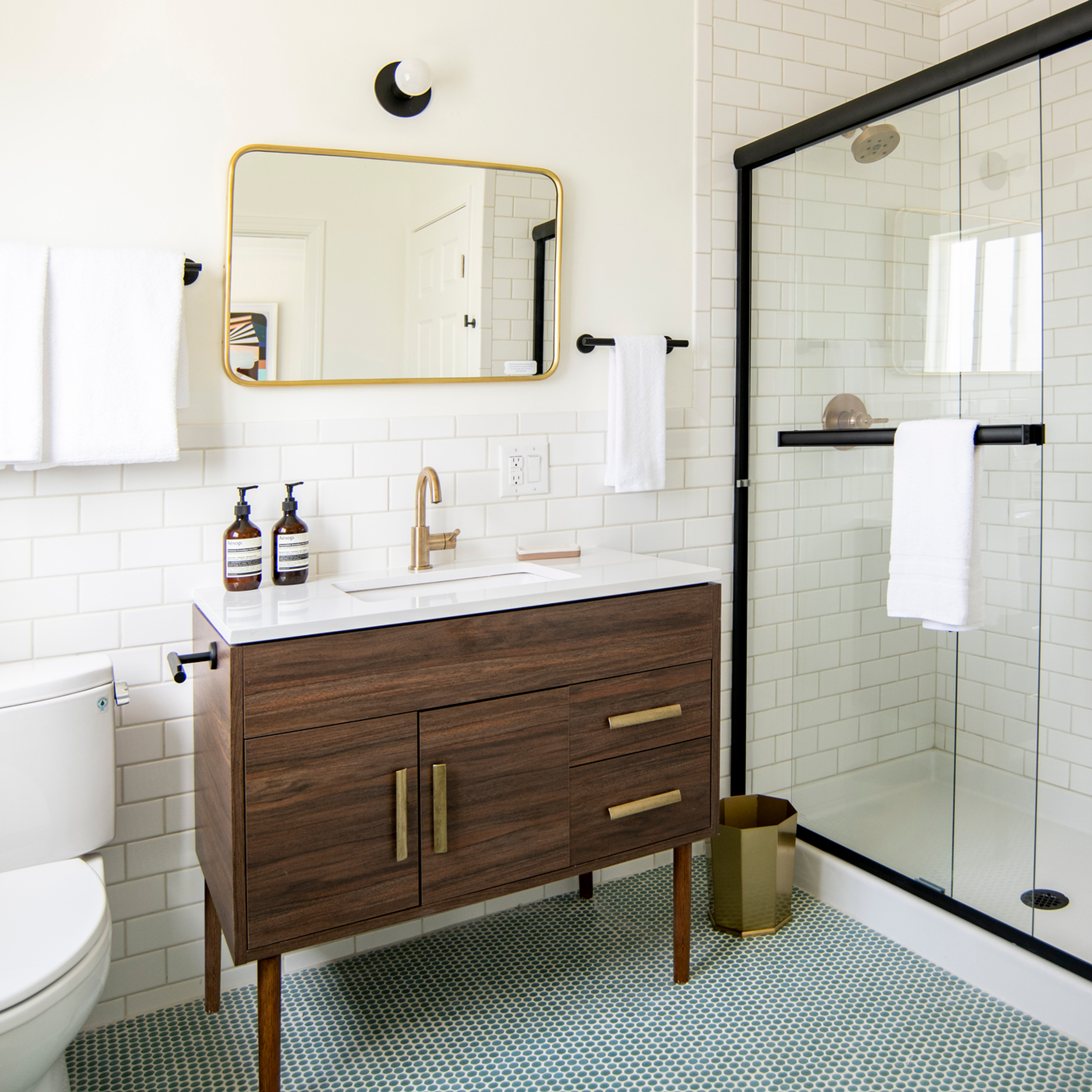Broadway Motel Oakland Christina Higham Sun Soul Style Interiors Mid Century bathroom subway tile mint penny tile brass hardware