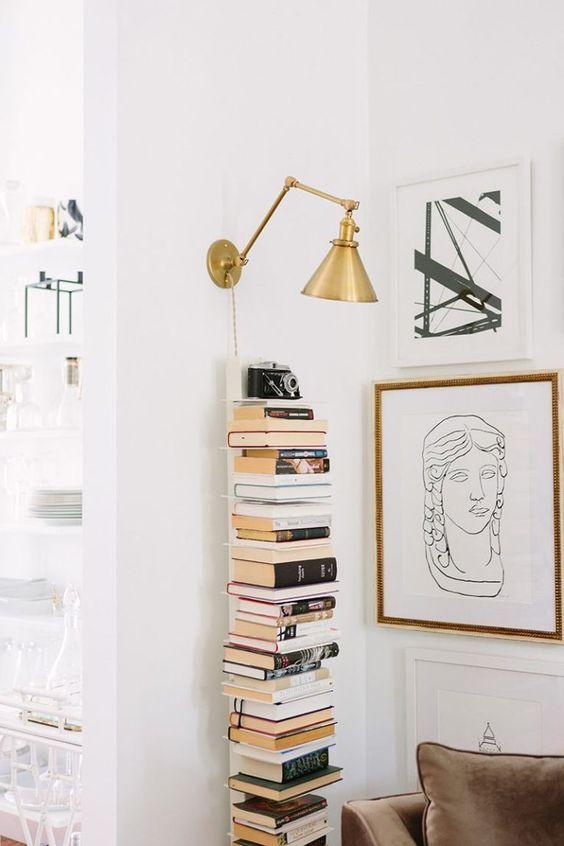 Bookshelf styling tips neutral books on wall