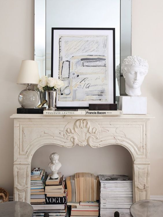 Styling tips neutral books in fireplace