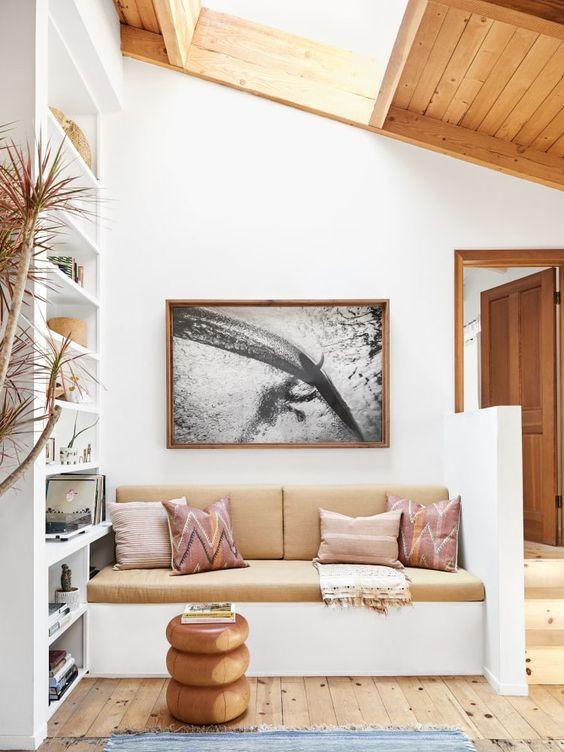 Bohemian living room built in bench kilim pillows surf beach house