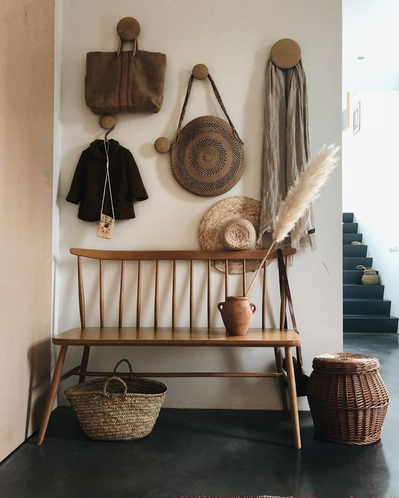 Styling tips bags and scarves hung on wall