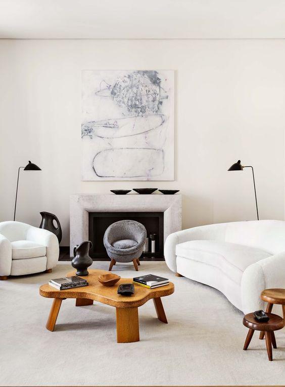 Jean Royere coffee table, Jean Royere interior design, polar bear sofa, white curve sofa, modern living room