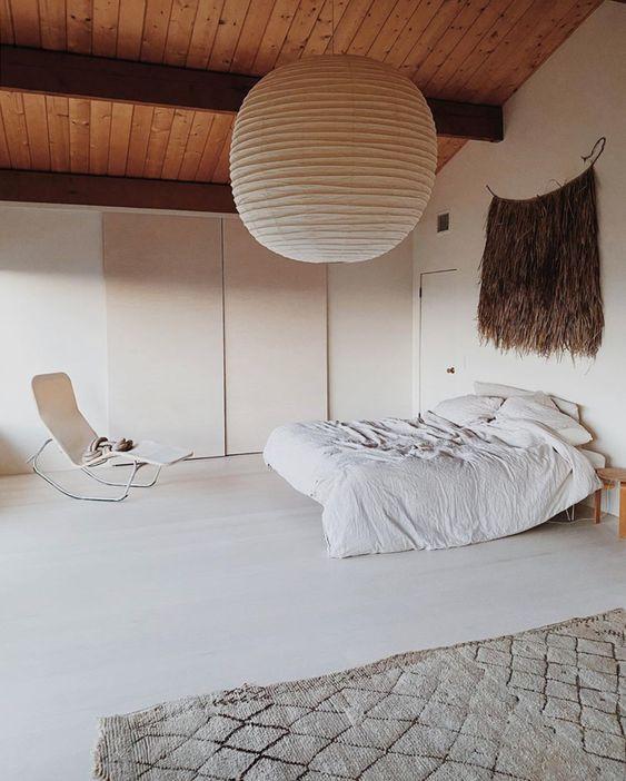 Oversized noguchi lantern lighting bohemian bedroom
