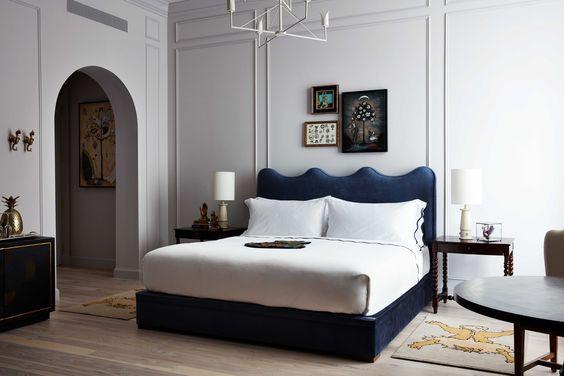 Maison De La Luz , New Orleans Hotel, curvy headboard, hotel room, bedroom, blue velvet bed
