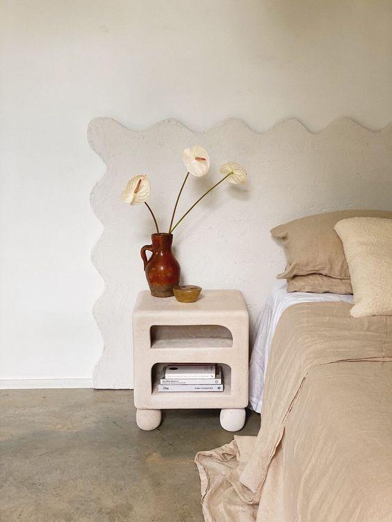 Curvy wavy headboard chunky nightstand plaster nightstand neutral bedroom design