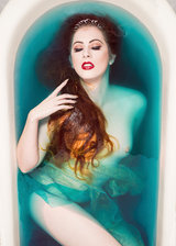 woman mermaid in a blue bath