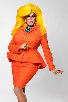 karen from finance wearing an orange dress and yellow wig