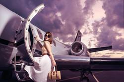 glamorous lady stepping onto a plane