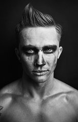 man in black and white skull makeup for halloween