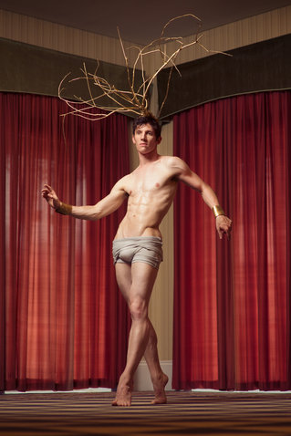 ballet dancer with antlers with red curtain
