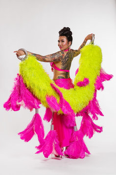 asian burlesque artist with yellow and pink feather boa