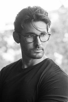 handsome man black & white headshot with glasses