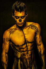 man in gold skeleton body paint for halloween