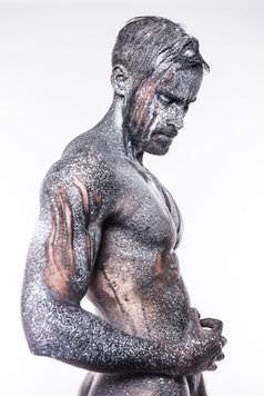 man covered in black and white paint