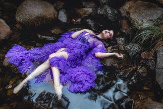 woman in purple silk robe in a creek, ophelia