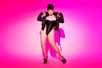 burlesque dancer wearing leather on a pink background